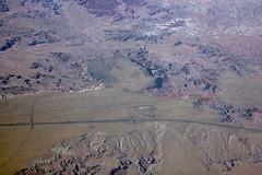 Aerial view of badlands in Petrified Forest National Park, Arizona (cocoi_m) Tags: arizona nature route66 aerial painteddesert historic geology i40 petrifiedforestnationalpark visitorcenter geomorphology aerialphotograph badland overlying chinleformation bidahochiformation unconformably petrafiedforestroad