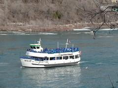 Niagara Falls. The Maid in the Mist boat trip heads to the Horseshoe Falls with passengers in their blue rain ponchos. (denisbin) Tags: bridge river niagarafalls boat border rainbowbridge maidinthemist usacanadaborder