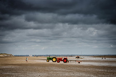Oyster Beach (Hugh Rawson) Tags: clouds france sky stgermainsuray normandy beach tractor cloud