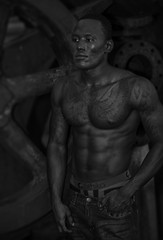Portrait of Patrick from Sierra Leone (crabsandbeer (Kevin Moore)) Tags: baltimore harbor man maryland model people industry fitness grayscale gears rust noir night tattoo african muscular fit