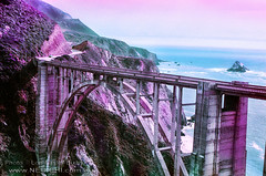 Span Across Time - Infrared (Lon Casler Bixby) Tags: loncaslerbixby landscapephotography landscapes neoichi nature naturephotography nikonphotography nikon bixbybridge oldbridges architecture structures streetphotography streetscenes streetscapes scapes oceanscape oceanview pacificocean interiordesign infrared infraredphotography filmphotography outdoorphotography 35mm lomochrome california bigsur fineartphotography fineart fineartprints purple cloudscape weatherscapes travelphotography travel transportation roads roadtrip wanderlust american america