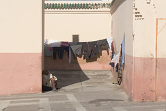 Sitting in the shade (k8moonevans) Tags: life africa street people urban nikon morocco marrakech medina washing