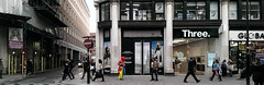 clown about town (dr_loplop) Tags: street autumn people panorama building london sign architecture grey three town day colours pavement clown dune columns f oxford shops pedestrians scaffold noentry primary walkin doric passersby egganddart colournation