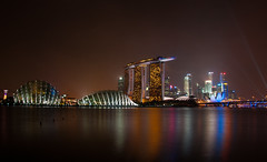Marina Bay on a Smoky Night (kieranburgess) Tags: city light sea reflection water skyline night marina bay singapore asia cityscape skyscrapers smoke south eerie coastal shore smoky domes atmospheric threetowers beamsoflight gardensbythebay marinabaysands artsciencemuseum