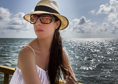 Portrait of Young Woman Traveling on Board a Small Boat (Marcos Felipe T.D.) Tags: morning sea summer brazil portrait sky cloud white reflection beautiful beauty hat sunglasses outdoors women day sailing sitting dress horizon small longhair straw wave sunny journey pensive youngadult vacations sunbathing boarding scenics oneperson contemplation caucasian alagoas tranquilscene brownhair watersurface traveldestinations beautyinnature nonurbanscene surfacelevel patacho horizonoverwater nauticalvessel portodepedras lookingatview