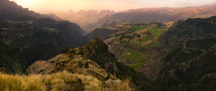 The Vastness of the Simiens (departing(YYZ)) Tags: africa travel pink sunset panorama mountains green nature yellow zeiss 35mm landscape countryside nationalpark view natural outdoor sony horizon farming scenic canyon fromabove craggy vista fe ethiopia alpha cinematic epic a7 rolling eastafrica simienmountains semien jawdropping sonnartfe35mmf28za