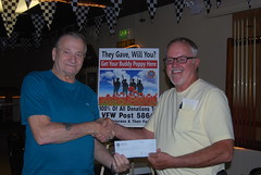 House Committee Member Don LaFountaine, left presents a check to Jim McIntire to go toward a new van for Johnson County