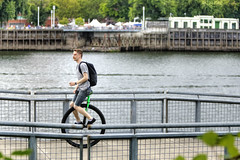 The Daily Commute (Ian Sane) Tags: camera two man oregon canon river portland lens ian eos is ic mark images ii unicycle esplanade backpack 5d usm northeast vera willamette katz sane ef70200mm eastbank f28l thedailycommute