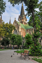 Church of Sts. Olha and Elizabeth in Lviv (krugli) Tags: old city building church architecture yard bench town europe day cathedral outdoor gothic lviv ukraine greenery neo neogothic lvov d90