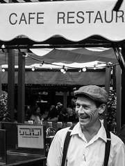 The smile of the waiter (Le petit oiseau va...) Tags: blackandwhite bw paris france caf smile restaurant blackwhite olympus montmartre waiter omd