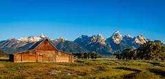 TA Moulton barn (mary_hulett) Tags: light mountains barn sunrise scenic historical homestead wyoming iconic mormonrow tetonnp antelopeflatsroad tamoultonbarn