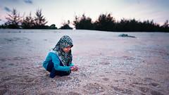 She Shells At The Sea Shore (Abdul Manaf Yasin) Tags: pantai seberangtakir children beach ekta color 169
