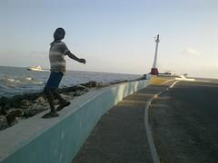Belizean boy at seafront (Sasha India) Tags: belizecity belize             caribbean