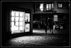 A la lumiere des boutiques (Maestr!0_0!) Tags: street windows light people white black canon eos candid rue vitrine noirblanc