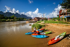Kayaks for Rent, Vang Vieng, Laos (syukaery) Tags: trip travel cruise vacation holiday men tourism rural river landscape asian boat town nikon scenery asia kayak scenic canoe d750 destination laos tamron vangvieng humaninterest 1735mm