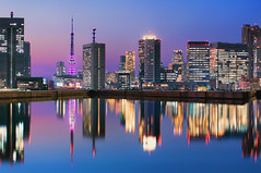 A Moment in Time (Suzuki san) Tags: ocean city longexposure travel bridge blue light sunset sea sky urban reflection building tower tourism water japan skyline architecture modern night skyscraper port dark asian japanese tokyo evening bay harbor boat town office rainbow twilight pond colorful asia cityscape view harbour outdoor dusk metallic capital sightseeing illumination officebuilding landmark structure architectural illuminated tokyotower coastline metropolis tokyobay nightfall rainbowbridge urbanlandscape urbanskyline locallandmark nationallandmark internationallandmark