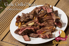 Garlic Grilled Steaks (Thinkarete) Tags: red food table outdoors restaurant wooden succulent healthy flavor beef napkin plate meat roast meal garlic spicy buffet sliced diet cooked grilled serving seasoning catering nutrition lean prepared mediumrare marinated