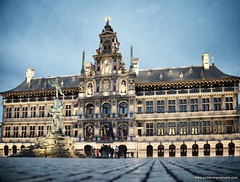 City Hall Antwerp at dusk. (Jochem.Herremans) Tags: city travel blue sky urban holiday building heritage history monument public fountain dutch architecture fairytale facade buildings giant square town hall ancient europe european hand belgium market space flag famous capital great gothic culture style landmark center flags medieval historic international government belgian antwerp ornate markt antwerpen stadhuis grotemarkt flanders grote mythical schoonverdiep
