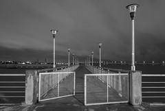 Alineado. (Pablin79) Tags: longexposure bridge light sky white black water argentina monochrome rain night river pier iron outdoor deck lanterns misiones posadas