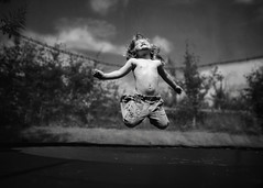 'Scuse me while I kiss the sky.... (markfly1) Tags: life sun cute art girl lines kids children happy photography jumping nikon funny child angle expression candid wide over sigma grace celebration d750 24mm joyous blissfully
