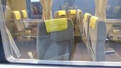 Swivelling seats (seikinsou) Tags: japan spring osaka kix kansai airport haruka jr train shinosaka seat swivel turn front video window reflection