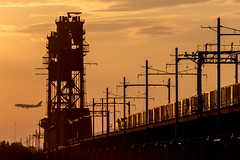 The Gate to Newark (ericwill) Tags: airplane bayone bridge csx catenary conrail fedex lehighvalley lift nj newjersey newark tower sunset