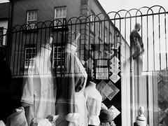Timeslip on Mill Street (Feldore) Tags: reflection cultra shop window old vintage period man tattoo northern ireland irish street feldore mchugh em1 olympus 1240mm clothes victorian