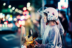 Motorbike Girl (Jon Siegel) Tags: nikon nikkor d810 85mm 14 nikon85mmf14 85mmf14 woman girl cute beautiful beauty helmet biker rider motorbike bokeh city lights urban night evening hongdae seoul southkorea korea korean people traffic