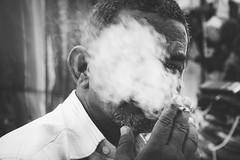 Smoke gets in your eyes. (Tarang Jagannath) Tags: smoking face portrait bw blackandwhite eye