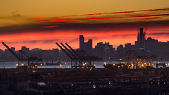 Port of Oakland (Ron Scubadiver's Wild Life) Tags: landscape urban industrial sunset oakland california nikon 70300 harbor clouds night