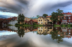 Old Town Clouds VII (henriksundholm.com) Tags: city trees houses sunset sky lake grass clouds reflections landscape cloudy sweden gamlastan sverige oldtown hdr eskilstuna waterscape eskilstunan