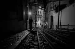 Lisbon Story #2 (glynbrownson) Tags: lisbon highcontrast mood city night noir atmosphere tracks streetphotography silhouette shadow dark ricohgr blackandwhite monochrome portugal