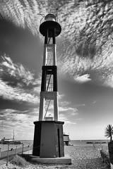 Gabicce's lighthouse (Mario Ottaviani Photography) Tags: sea blackandwhite bw lighthouse white seascape black beach monochrome clouds canon grey monocromo gray bn shore bianco nero biancoenero gabicce gabiccemare sonyalpha fotodiox a7rii a7rmkii a7r2