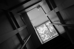 Abysmal (karmakerosene) Tags: window stairs stairway staircase light shadows bokeh architecture depthoffield angle simple doorway blackandwhite monochrome monochromatic bw nikond7000 nikon d7000 35mm