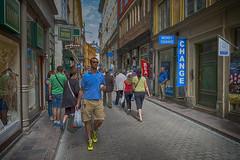 Walking in the street (la1cna) Tags: color walking colors sweden edited oldbuilding street city streetphoto summer urbanliving fujifilm stockholm streetphotography travel urban 21mm people