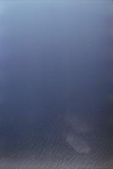 august 2014 (Tefilo de Sales) Tags: sky plane airplane air horizon sunrise analog analogic film fuji fujifilm fujixtra400 35mm expired erasmus malta blue nikkormatel nikkormat nikon nikkor ocean clouds reflection