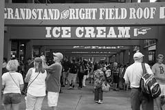 Ice Cream (peterkelly) Tags: people bw usa hat boston digital us unitedstates baseball stadium massachusetts unitedstatesofamerica crowd fries icecream backpack northamerica fans fenwaypark bostonredsox stands grandstand mlb knapsack concessions