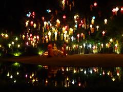 Buddhist temple - Chiang Mai, Thailand (ashabot) Tags: travel people colors night reflections dark thailand lights seasia nightlights festivals buddhism monks serenity temples chiangmai nightshots wat lightanddark loikrathong thaifestivals watphantao