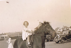 Horsepower in the front, more Horsepower in the background (TrueVintage) Tags: horse cars girl animal 1930s kid child kind riding oldphoto autos past pferd foundphoto mdchen reiten vintagecars horseriding vergangenheit vintagephoto vintagekid vintageanimal