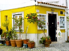 Alfama tourist shop house (pedrosimoes7) Tags: travel portugal yellow shop architecture arquitectura lisbon cc creativecommons portuguese loja alfama touristshop arquitecturaportuguesa lojaparaturistas
