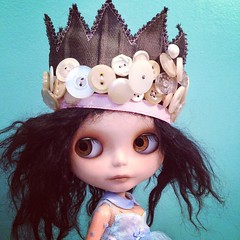 Working on a new crown with antique buttons from the 60s through the 90s...tired eyes