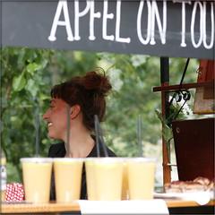 Apfel on tour (PIKTORIO) Tags: portrait berlin apple girl smile bicycle germany stand juicy market juice candid cart typo apfel sneaky neuklln saft piktorio