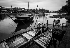 Hoi An 05 (arsamie) Tags: wood old city bridge shadow white black reflection water hat rain weather river pier boat town wooden women triangle asia cone bad an calm vietnam serenity hoi colonialism