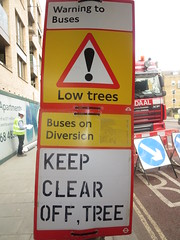 Sign to be read by bus and tree (John Steedman) Tags: uk greatbritain england london sign unitedkingdom grossbritannien     grandebretagne