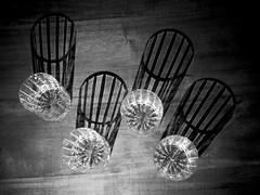 Shadowplay (smithnik477) Tags: minimal shimmer light monochrome blackandwhite shadow glasses cups glass