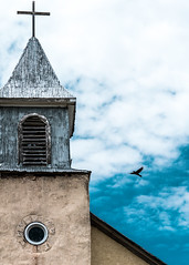 order and chaos (Eric Baggett) Tags: newmexico church flight bird solitude blue sky clouds sonya7rii wild architecture wildwest nearsantafe southwest nature mothernature gratitude chance luck hawk