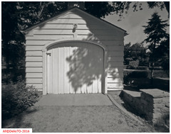 White garage door (DelioTO) Tags: 4x5 architecture autaut blackwhite canada d23 doors f175 historical july ontario pan100 pinhole rural summer toned trails