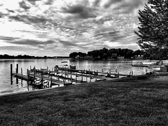 Season's End, Spring Lake (Dennis Sparks) Tags: docks boats blackwhite michigan springlake iphone