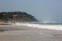 Varkala beach in the day (Sergey Mikushev) Tags: ocean travel blue sea summer sky sun sunlight holiday seascape tourism nature water beauty horizontal outdoors bay landscapes sand asia surf turquoise vibrant space sandy tide wave nobody scene edge heat beaches tropical backgrounds waters coastline remote cay idyllic vacations climate scenics locations nonurban