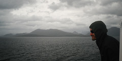 In Patagonia (cortomaltese) Tags: chile sunglasses clouds sailing ship rainy grin blackhood patagonicfjords